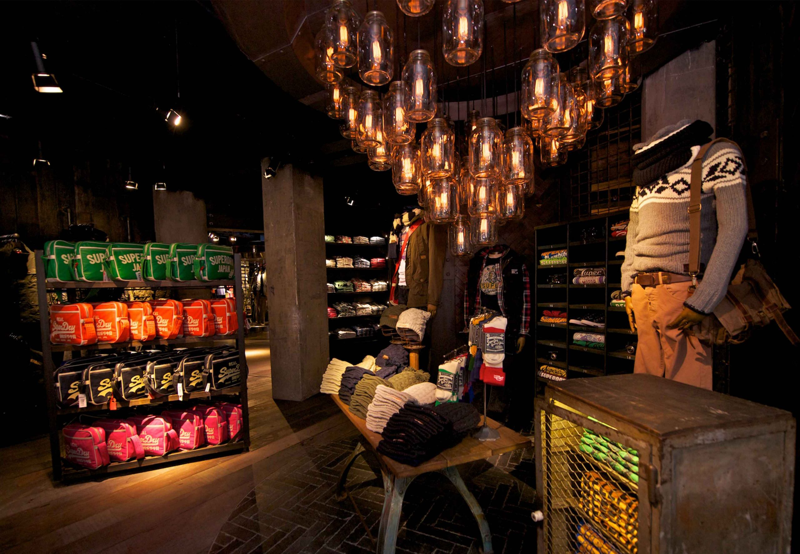 Retail Lighting Scheme Fashion Store Feature Pendants Dark Moody Interior Studio N